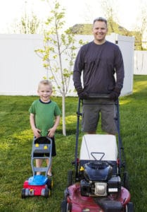 Mowing And Treating Grass